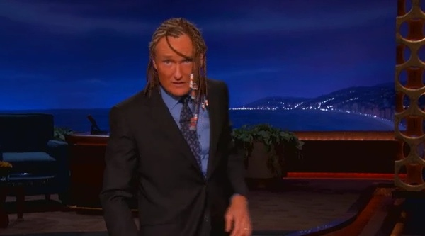 Conan, spray-tanned orange with cornrows, for your benefit