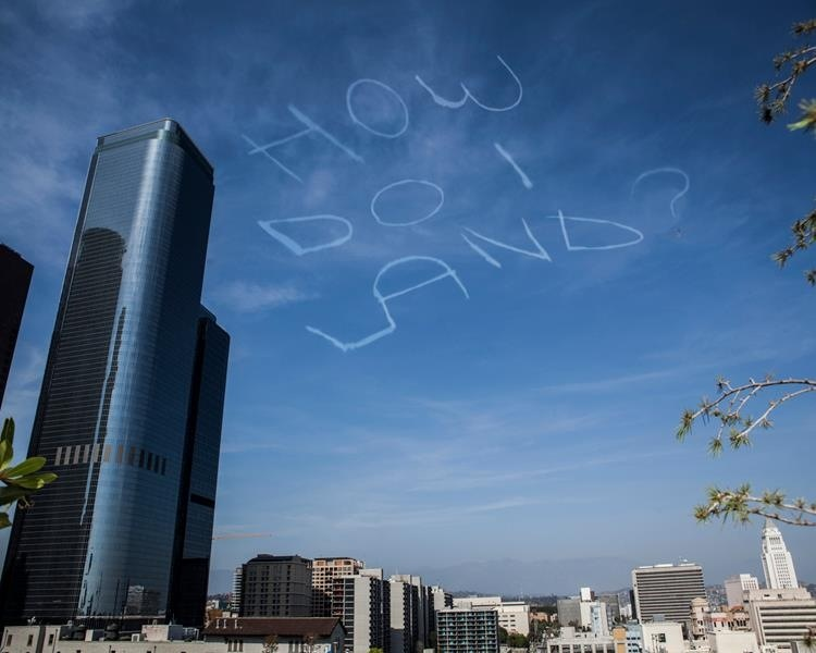 """How Do I Land?"" Kurt Brauohler's Cloud Project is a humor lesson in skywriting, gift of absurdity"