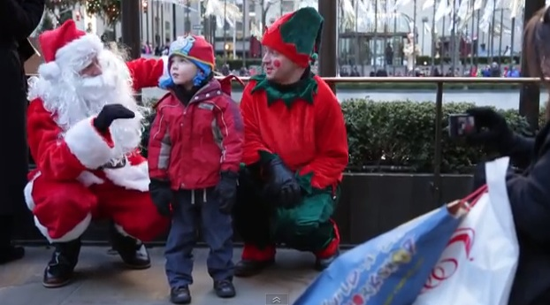 Santa freestyle raps his presents for New York City tourists