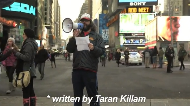Judah Friedlander pays off Super Bowl bet to Taran Killam with Times Square apology