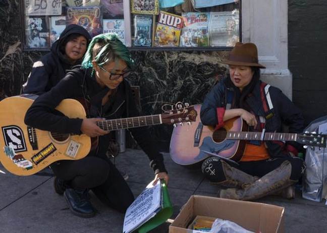 Margaret Cho busking in the streets of San Francisco to #BeRobin, help the homeless