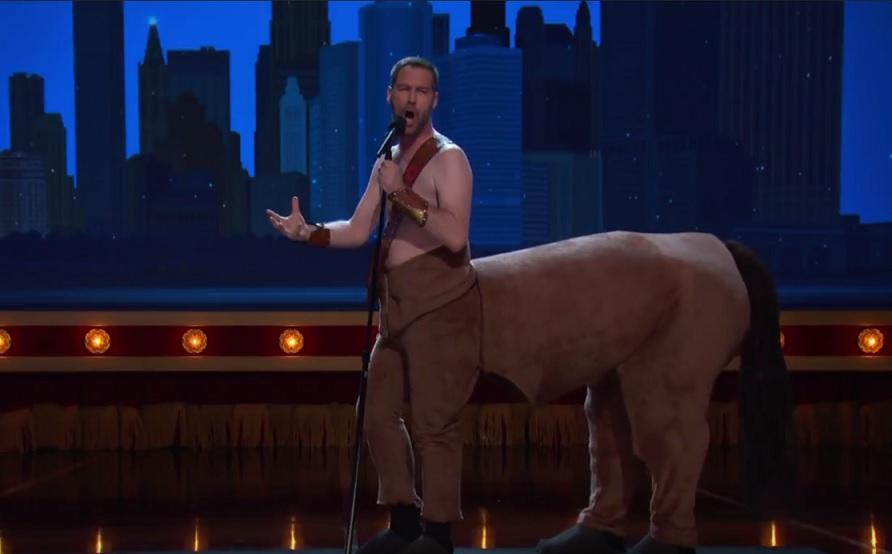 Jon Dore performs as a centaur on Conan