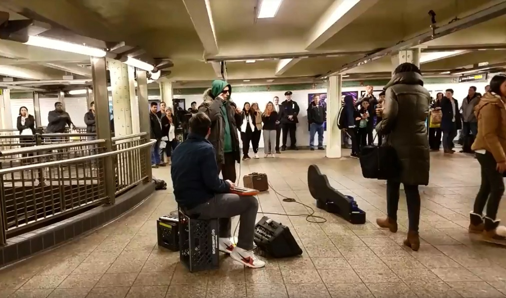 Adam Sandler performs publicly at Comic Strip Live, in disguise at the Times Square subway station